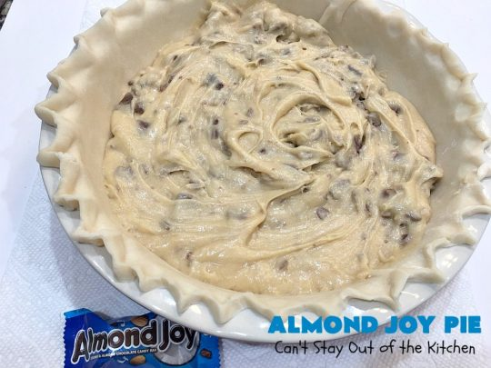 Almond Joy Pie | Can't Stay Out of the Kitchen | this fantastic #pie is filled with #AlmondJoyBars. So it's loaded with #chocolate, #coconut & #almonds. Every bite is breathtaking. Great #dessert for company or #holidays like #ValentinesDay. #HolidayDessert #ValentinesDayDessert #AlmondJoyDessert #AlmondJoyPie #ChocolateDessert #CoconutDessert #AlmondDessert