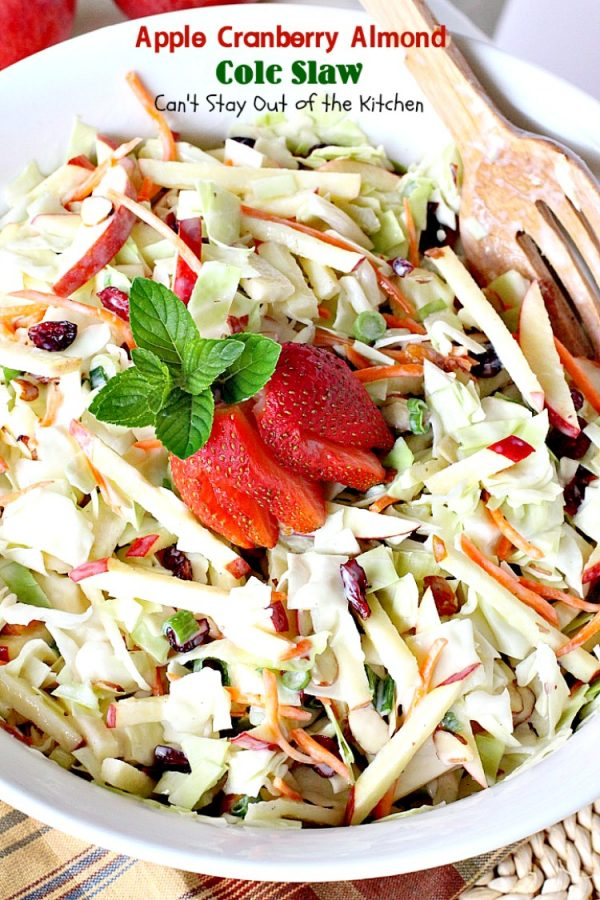 Apple Cranberry Almond Cole Slaw   Can't Stay Out of the Kitchen   this #coleslaw is amazing. It's filled with #apples #almonds #craisins #celery & #carrots in a tasty #Greekyogurt dressing. Healthy, low calorie & #glutenfree. #cabbage