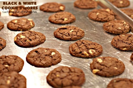 Black and White Cookie S'Mores | Can't Stay Out of the Kitchen | this fantastic #PaulaDeen #recipe includes #chocolate bars, #GrahamCrackers and #WhiteChocolateChips in the #cookie. Each one is put together with #MarshmallowCreme. These are the ultimate in #SmoresCookie! Great for #holiday #baking & #ChristmasCookieExchanges too. #Smores #dessert #SmoresDessert #BlackAndWhiteCookieSMores