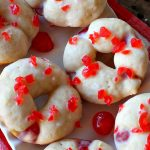 Cherry Almond Donuts | Can't Stay Out of the Kitchen | these luscious #donuts are filled with #cherries & #almond extract. They're glazed with an almond-flavored powdered sugar icing & topped with chopped cherries. Perfect for #ValentinesDay or any #holiday #breakfast. #HolidayBreakfast #ValentinesDayBreakfast #CherryDonuts #CherryAlmondDonuts