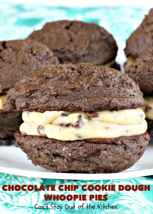 Chocolate Chip Cookie Dough Whoopie Pies   Can't Stay Out of the Kitchen   these outrageous #cookies are like a meal to themselves! Rich, decadent & so chocolaty. No eggs in the #cookiedough filling either. #chocolate #dessert #ChocolateChip #ChocolateChipCookieDough #WhoopiePies #ChocolateDessert #ChocolateCookie #ChristmasCookieExchange #ValentinesDay #ValentinesDayDessert #Holiday #Tailgating #HolidayDessert