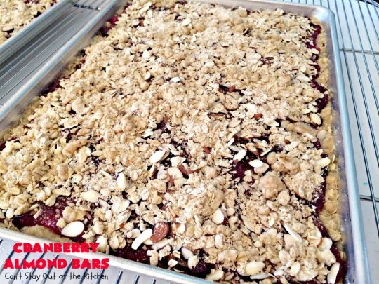 Paula Deen's Cranberry Almond Bars | Can't Stay Out of the Kitchen | fabulous #PaulaDeen #cookie recipe with a streusel crust and topping. The filling is made with fresh #cranberries & #pineapple preserves & #almonds on top. This is a terrific #dessert for #Christmas baking.