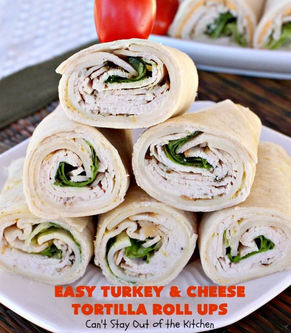 Easy Turkey and Cheese Tortilla Roll Ups | Can't Stay Out of the Kitchen | these fantastic wraps make a terrific treat for #tailgating parties, potlucks or soccer games. Easy & delicious. #sandwiches #cheese #TurkeySandwiches #TurkeyWraps #TurkeyRollUps #PepperJackCheese #SwissCheese #CheddarCheese