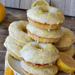 Glazed Lemon Poppyseed Donuts   Can't Stay Out of the Kitchen   these #donuts are awesome! They have #lemon juice & lemon zest in both the donut and icing. Terrific for a weekend or #holiday #breakfast. #poppyseeds #HolidayBreakfast #LemonPoppyseedDonuts #HomemadeDonuts