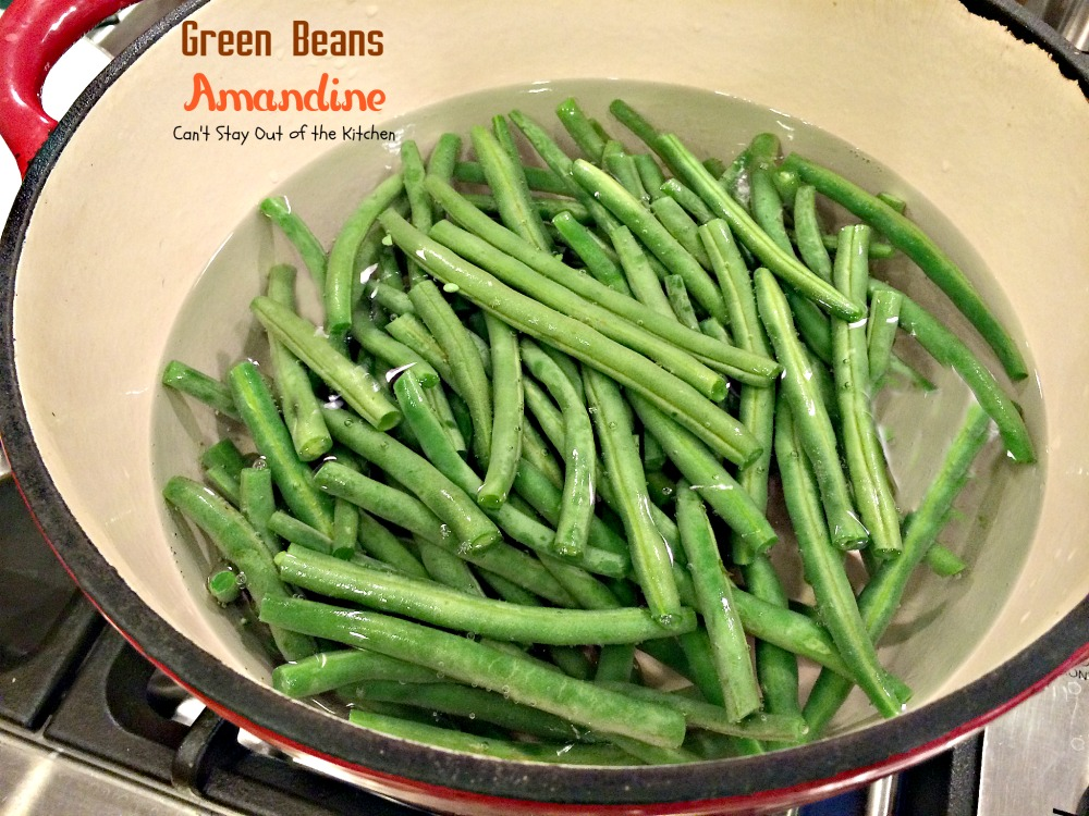 Wash green beans. Trim ends. Add green beans to water in large sauce ...