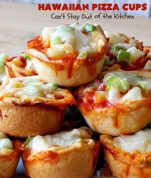 Hawaiian Pizza Cups | Can't Stay Out of the Kitchen | these fantastic miniature #pizzas are the best #appetizer of choice for #tailgating parties or the #SuperBowl! They're filled with spaghetti sauce, #ham, #pineapple & green bell pepper. Every bite is so mouthwatering, you'll be fighting others for the last one! #MozzarellaCheese #PillsburyRefrigeratedBiscuits #MiniaturePizzas #HawaiianPizzaCups