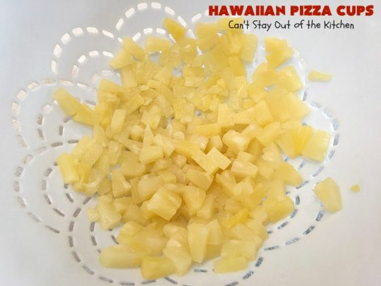 Hawaiian Pizza Cups   Can't Stay Out of the Kitchen   these fantastic miniature #pizzas are the best #appetizer of choice for #tailgating parties or the #SuperBowl! They're filled with spaghetti sauce, #ham, #pineapple & green bell pepper. Every bite is so mouthwatering, you'll be fighting others for the last one! #MozzarellaCheese #PillsburyRefrigeratedBiscuits #MiniaturePizzas #HawaiianPizzaCups