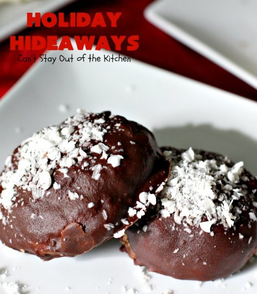 Holiday Hideaways | Can't Stay Out of the Kitchen | these scrumptious #cookies have a #maraschinocherry hidden inside each one! Then they're dunked in #chocolate or #vanilla bark before sprinkling with additional bark shavings. So festive & beautiful for #holiday or #Christmas #baking. #Christmas #ChristmasDessert #ChristmasCookieExchange #cherries #ChocolateDessert #CherryDessert #dessert