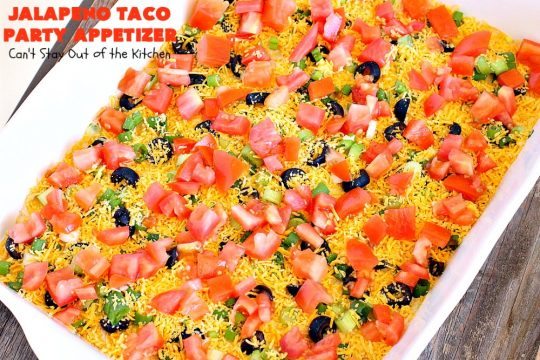 Jalapeno Taco Party Appetizer | Can't Stay Out of the Kitchen | the best #TexMex layered dip ever! This one uses refried beans with jalapenos, #avocados, a sour cream & #taco seasoning layer. Then it's topped with olives, #cheese, green onions and tomatoes. Perfect for #tailgating or #SuperBowl parties. #appetizer