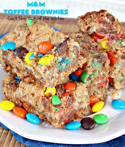 M&M Toffee Brownies | Can't Stay Out of the Kitchen | these #brownies are nothing short of sensational! They're filled with #MMs, #coconut, #pecans & #HeathEnglishToffeeBits. Terrific for #tailgating parties, potlucks, backyard BBQs & summer #holiday fun like #FourthOfJuly. #MMDessert #chocolate #HolidayDessert #ToffeeDessert #toffee #ChocolateDessert