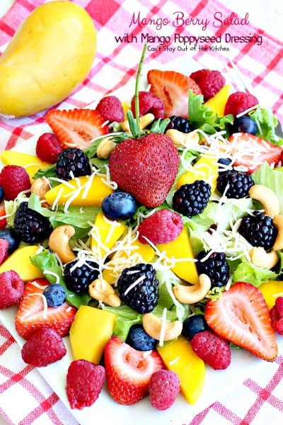 Mango Berry Salad with Mango Poppyseed Dressing | Can't Stay Out of the Kitchen | this amazing #salad has double the #mango flavor. Filled with #strawberries #raspberries #blueberries #blackberries & #swisscheese. We love this #salad. #glutenfree #cleaneating
