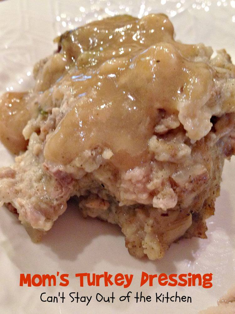 ... close up picture of Mom's Turkey Dressing topped with Turkey Gravy