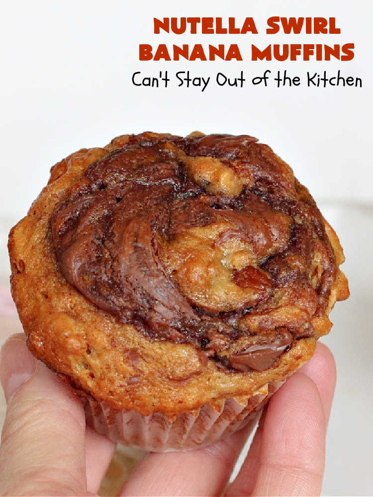 Nutella Swirl Banana Muffins   Can't Stay Out of the Kitchen   these outrageous #muffins are filled with #almonds & #bananas and swirled with #Nutella! These are so heavenly you won't be able to stay out of them. #breakfast #holiday #HolidayBreakfast #NutellaMuffins #NutellaSwirlBananaMuffins