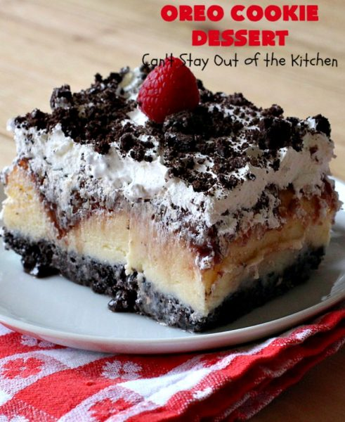 Oreo Cookie Dessert | Can't Stay Out of the Kitchen | This spectacular #dessert is rich, decadent & so addictive! No one will want only one piece! The bottom layer is crushed #Oreos. Layered with #BlueBell vanilla ice cream, then it has a homemade #fudge & walnut sauce. It's topped with #CoolWhip & more #Oreos. #OreoDessert #ChocolateDessert #IceCreamDessert #FudgeDessert #ValentinesDayDessert #HolidayDessert