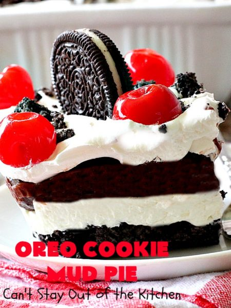 Oreo Cookie Mud Pie | Can't Stay Out of the Kitchen | this spectacular layered #dessert has an #Oreo crust, a #cheesecake layer, a #chocolate #pudding layer, and a #CoolWhip layer with #maraschinocherries. This amazing dessert is always raved over whenever I make it! #chocolatedessert #OreoDessert