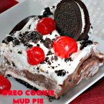 Oreo Cookie Mud Pie | Can't Stay Out of the Kitchen | this is one of our favorite #holiday desserts. It's terrific for #ValentinesDay & special occasions. This heavenly #dessert has an #Oreo crust, a #cheesecake layer, a #chocolate pudding layer, whipped topping & maraschino #cherries. Yum, it's so good!