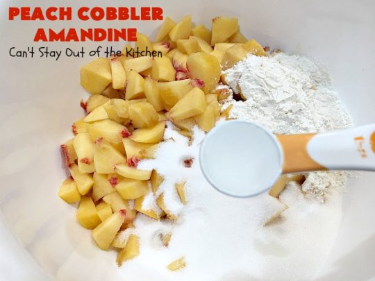 Peach Cobbler Amandine | Can't Stay Out of the Kitchen | this delightful #PeachCobbler #recipe uses #almonds, almond extract & almond meal to really bump up the flavors. It's a scrumptious #dessert to make with fresh #peaches. #PeachDessert #PeachCobblerAmandine #Canbassador #WashingtonStateFruitCommission #WashingtonStoneFruitGrowers #WashingtonStateStoneFruitGrowers