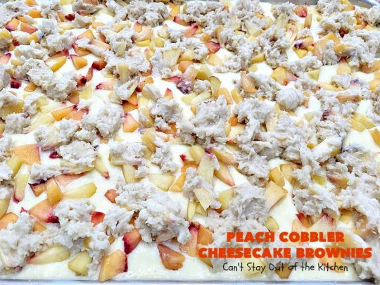 Peach Cobbler Cheesecake Brownies | Can't Stay Out of the Kitchen | these spectacular #brownies start with a #peachcobbler #cookie dough. They have a luscious #cheesecake filling in the middle, topped with fresh #peaches. Then more cookie dough is crumbled over top. These were a huge hit at my husband's office. #dessert #peachdessert #CANbassador #WashingtonStateFruitCommission #WashingtonStatestoneFruitGrowers