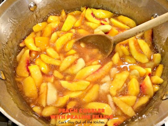 Peach Cobbler with Praline Filling | Can't Stay Out of the Kitchen | this luscious #peach #cobbler has #praline pie crust rolls on top. Absolutely divine! Perfect #dessert for summer.