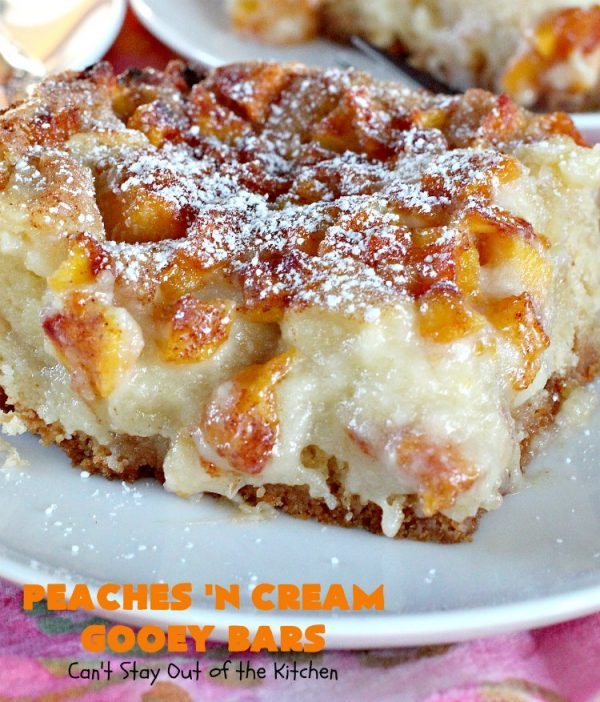 Peaches 'n Cream Gooey Bars   Can't Stay Out of the Kitchen   these ooey, gooey blondies are absolutely divine! They're filled with #cheesecake filling & topped with fresh #peaches & #cinnamon-sugar. Perfect for summer #holiday menus like #FathersDay #MemorialDay & #FourthofJuly. #dessert