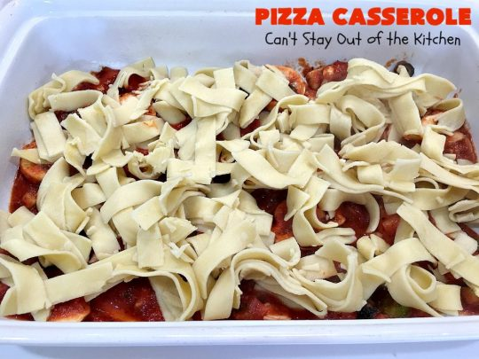 Ten Layer Pizza Casserole | Can't Stay Out of the Kitchen | This fantastic #casserole tastes like eating #pizza or #lasagna. It's filled with #GroundBeef, #noodles, #pepperoni #RicottaCheese, #Mozzarella Cheese & amped up #SpaghettiSauce. Our company raved over this #Italian #MainDish. #PizzaCasserole #TenLayerPizzaCasserole
