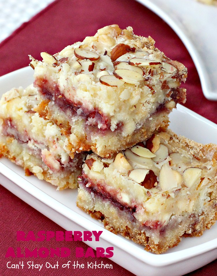 Raspberry Almond Bars   Can't Stay Out of the Kitchen   these irresistible #brownies are rich, decadent & absolutely sensational! They're perfect for #holiday & #Christmas #baking as they are so festive & beautiful. These layered #cookies use vanilla chips, #Raspberry preserves & #almonds. #holidaybaking #ChristmasCookieExchange #dessert #raspberrydessert