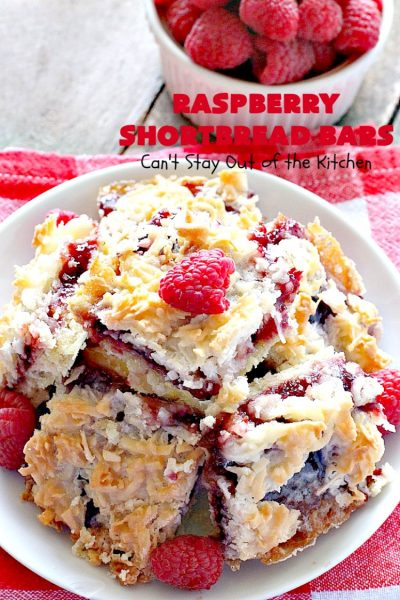 Raspberry Shortbread Bars | Can't Stay Out of the Kitchen | these #cookie type bars are absolutely divine! They have a shortbread crust, topped with #raspberry preserves & a #coconut topping. You'll be drooling over every bite! #dessert