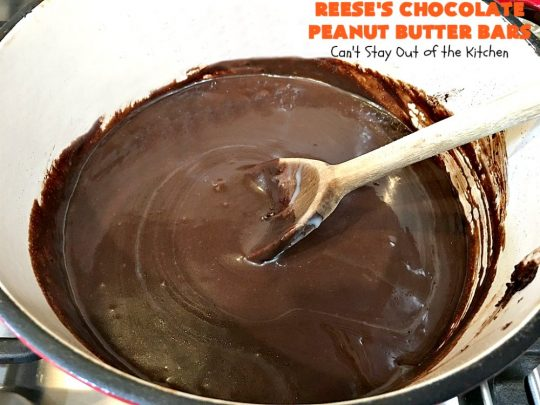 Reese's Chocolate Peanut Butter Bars | Can't Stay Out of the Kitchen | these outrageous #cookies start with an #OatmealCookie & #PeanutButter crust & topping. They have a #chocolate sauce & #ReesesPeanutButterCandies in the middle. Absolutely awesome! #tailgating #brownie #dessert #ChocolateDessert #PeanutButterDessert #ReesesPeanutButterDessert #ReesesChocolatePeanutButterBars