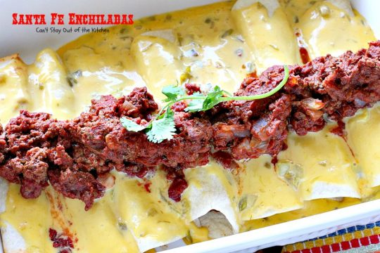 Santa Fe Enchiladas | Can't Stay Out of the Kitchen | these delicious #enchiladas have a #beef filling without beans. Then they're drenched in a cheesy #Velveeta sauce with #greenchilies & topped with more beef sauce. #Tex-Mex