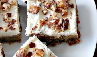 Snickers Blondies with Vanilla Buttercream Frosting