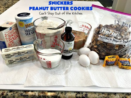 Snickers Peanut Butter Cookies   Can't Stay Out of the Kitchen   these luscious #cookies are loaded with #SnickersPeanutButterBars. The #caramel, #chocolate & #PeanutButter flavors really come through making this one dynamite #dessert. If you enjoy #SnickersCandyBars, you'll rave over this #SnickersDessert. #PeanutButterDessert #ChocolateDessert #HolidayDessert #CaramelDessert #SnickersPeanutButterCookies #tailgating #ChristmasCookieExchange