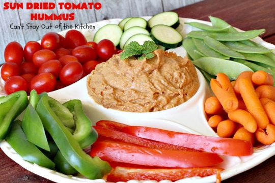 Sun Dried Tomato Hummus | Can't Stay Out of the Kitchen | this #hummus #recipe is fantastic! It includes #SunDriedTomatoes & just a little heat from cayenne pepper. This amazing #appetizer is healthy, low calorie, #GlutenFree & #vegan. Plus it can be whipped up in about 5 minutes! #tailgating #GarbanzoBeans #SunDriedTomatoHummus