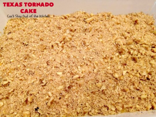 Texas Tornado Cake | Can't Stay Out of the Kitchen | this quick & easy #cake #recipe looks like a tornado hit it after baking! It's filled with #walnuts and #FruitCocktail. The #caramelized icing contains #coconut. This vintage cake will knock your socks off! #dessert #TexasTornadoCake #FruitCocktailCake #peaches #pears #EasyDessertRecipe #Holiday #HolidayDessert #ValentinesDay #ValentinesDayDessert