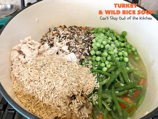 Turkey and Wild Rice Soup | Can't Stay Out of the Kitchen | this fantastic #soup is the perfect comfort food for the cold, dreary nights of winter. It will warm you up and put a smile on your face! #Turkey #TurkeySoup #TurkeyandWildRiceSoup #greenbeans #carrots #peas #WildRice #GlutenFree #mushrooms #Fall #FallSoupRecipe #GlutenFreeSoup #GlutenFreeTurkeySoup