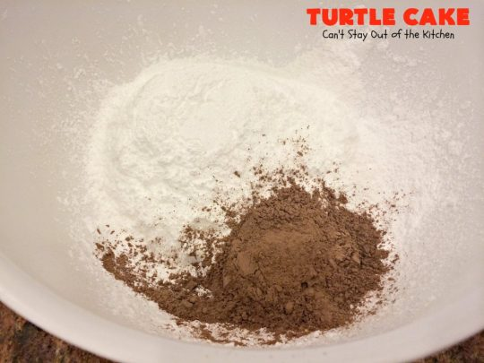 Turtle Cake | Can't Stay Out of the Kitchen | the richest, most decadent & divine #dessert ever! Tastes like eating #TurtleCandies but in #cake form. Uses #chocolate cake mix, #caramels melted with condensed milk, chocolate chips & pecans and topped with a luscious chocolate #marshmallow frosting.