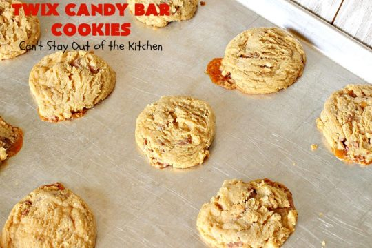 Twix Candy Bar Cookies | Can't Stay Out of the Kitchen | these fantastic #cookies are to die for! They're filled with #TwixCandyBars so they have great #chocolate & #caramel taste. We gave them out for a local town Christmas celebration & hundreds of folks raved over these goodies. #dessert #Holiday #HolidayDessert #CaramelDessert #ChocolateDessert #TwixCandyBarDessert #TwixCandyBarCookies #ChristmasCookieExchange #tailgating