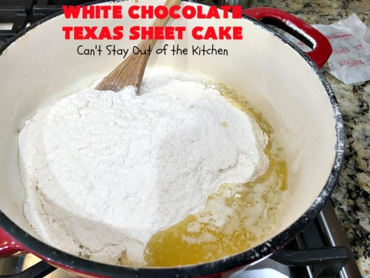 White Chocolate Texas Sheet Cake   Can't Stay Out of the Kitchen   spectacular #TexasSheetCake made with #Ghirardelli #WhiteChocolate instead! Terrific for potlucks, #tailgating parties or any kind of family get-together. #holiday #chocolate #HolidayDessert #ChocolateDessert #WhiteChocolateTexasSheetCake